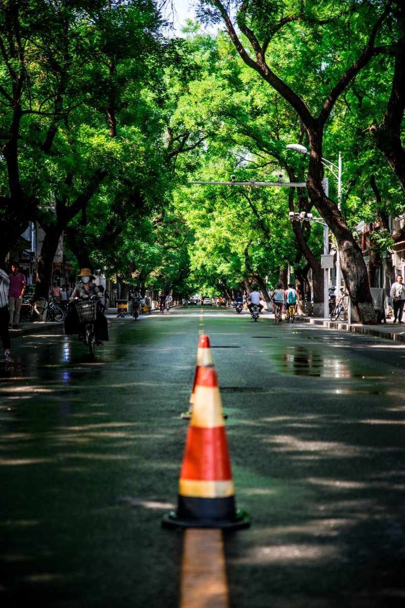 two-red-and-white-traffic-cones-in-middle-on-road-1236723